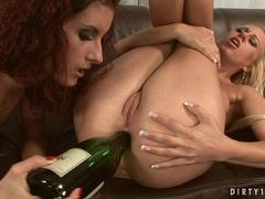 Blonde cutie Carla Cox gets her ass stuffed by a big wine bottle