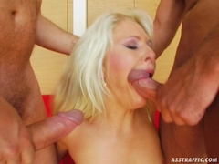 Busty Blonde Kathy Anderson deepthroating on two huge fat boners