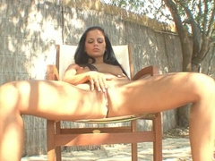 Zafira on outdoor gets naked and plays her cunt