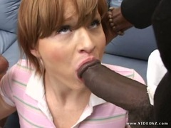 Naughty babe Sophie Dee blows a huge black cock