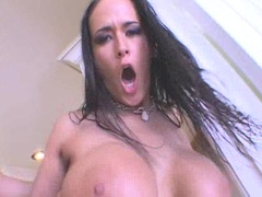 Carmella Bing gets sprayed on her big juggs with a warm jizz