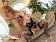 Blonde eurobabe Cindy Dollar showing her deepthroating talent