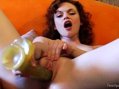 Sexy redhead Justine Jolie shoving a massive toy dildo in her tiny pussy
