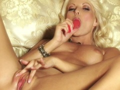 Sexy Anna Nova shoving her pussy with a huge pink dildo toy