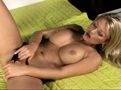 Busty Anette Dawn plays with her hot wet twat in the bed