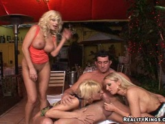 Horny big boobed milfs Emilianna and friends sharing a young stud's cock