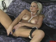 Busty blonde Abbey Brooks tooling her pussy with a big dildo toy