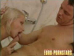 Blonde babe Angie Scott blows a hard meatpole at the shower room