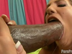 Busty babe Kelly Divine packed her mouth with a gigantic black cock