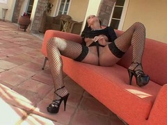 Hot babe Mili Jay wearing hot stockings and masturbating on a couch outdoors