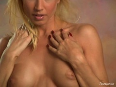 Sexy blonde babe Angie Savage plays her big tits and pink pussy