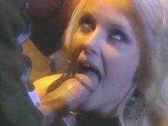 Tall blond Hannah Harper deepthroating a massive stiff