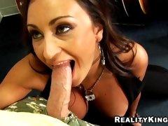 Busty milf Claudia Valentine deepthroating a huge fat meatpole
