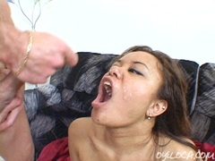Annie Cruz recieves a double load of cum in her mouth