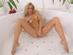 Fine blonde Stacy Silver gets her body wet and fingers her sweet twat