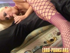 Fine Stacy Silver gives a huge dick a good blowjob and footjob