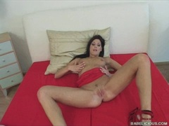 Sweet Evelyn Lory masturbating on the bed