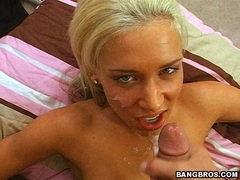 Kacey Jordan gets sprayed with a warm load of cum on her mouth