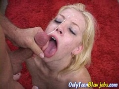 Leah Luv gets sprayed with a fresh load of cum on her mouth