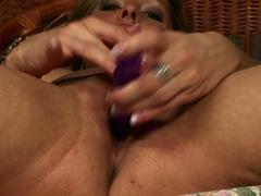 Naked babe Caroline Cage fills her sluthole deep with a lusty toy