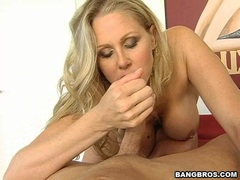 Horny Julia Ann feeds her mouth with a lucky man's corn dog she really likes