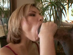Horny Leah Livingston stuffs her mouth with an irresistible meatpole