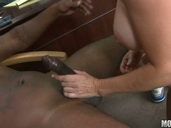 Hot momma Totally Tabitha is fucking her mouth with a massive erect cock