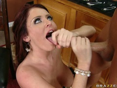 Filthy whore Sophie Dee opens her mouth and receives a nice load of goo