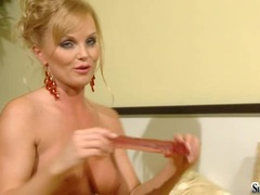 Sexy blonde Sylvia Saint takes her pleasure toy in her mouth like her man's cock
