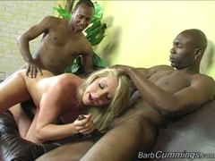 Barbie Cummings hooks her mouth on a fat cock