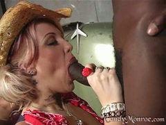 Candy Monroe hot cowgirl smoking a black pole