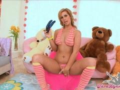 Tara Lynn blowing her favorite rubber toy