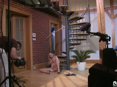 Sylvia Saint sitting on the floor caressing her clit