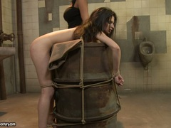 Anna Marie La Sante tied on the drum with a rope