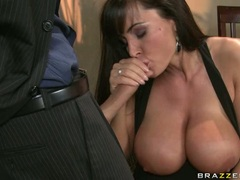 Lisa Ann rubbing her partner's dick while in a dinner