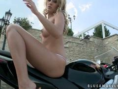 Blue Angel blonde fingering on her big bike