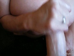 Kelly Madison torments this dick to a hand job