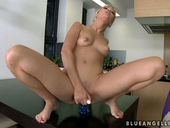 Blue Angel sitting on a dildo on the table