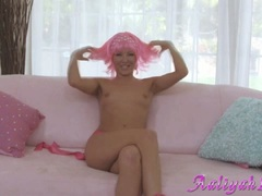 Aaliyah Love sitting on couch alone and naked