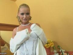Kathia Nobili babe sexy in white corset and stockings