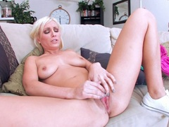 Lexi Swallow lie on couch and do finger fuck