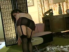 Kira Reed dancing as she strips down to stockings