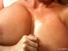 Kelly Madison sliding beefy dick between flesh melons