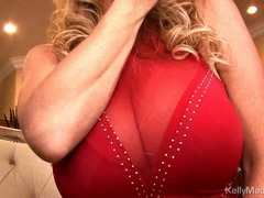 Kelly Madison lifts her dress exposing her wet pussy
