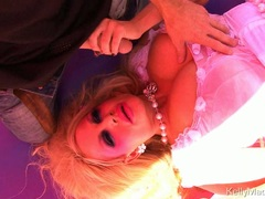 Birthday girl Kelly Madison blowing her man candle