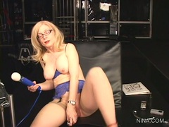 Nina Hartley pleasures her pussy with this vibrator