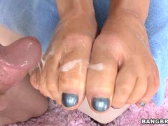 Slut Abbey Brooks gets her feet splattered with jizz