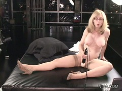 Amazing Nina Hartley toys her soaking wet snatch