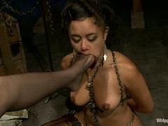 Bobbi Starr crams her toes into Annie Cruz's mouth