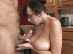 MILF Alia Janine oils up a cock and empties its tube